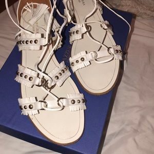 White Aquazurra tie up tassel sandals